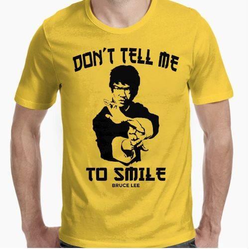 https://media1.positivos.com/136168-thickbox/don-t-tell-me-to-smile-bruce-lee.jpg